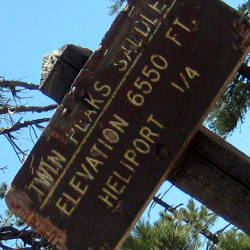 Sign: Twin Peaks Saddle. Elevation 6550 ft.